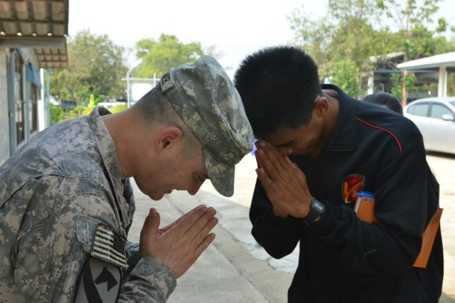 Lt. Col. Shawn Creamer (left), commander of the South Korea-based 2-9th Infantry, offers a traditional Thai greeting.