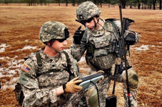 Spc. Michael Piatzer (left), and Staff Sgt. Jacob Wendland operate an unmanned aerial system, Jan. 16, 2013, during Army Expeditionary Warrior Experiment event.