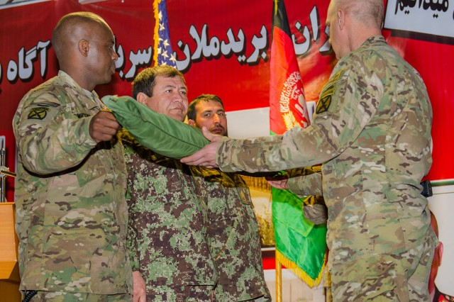1st Security Force Assistance Brigade, 10th Mountain Division (LI), uncases brigade colors