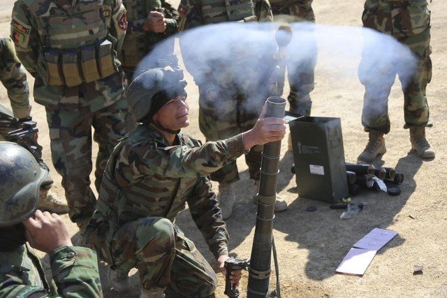Afghan Commandos from 3rd Company, 7th Special Operations Kandak, fire a 60mm indirect fire system during weapons practice on a range in Helmand Province, Afghanistan, Feb. 6, 2013. Commandos are mentored by their coalition force partners and review correct firing procedures and safe handling techniques to increase accuracy and combat effectiveness.