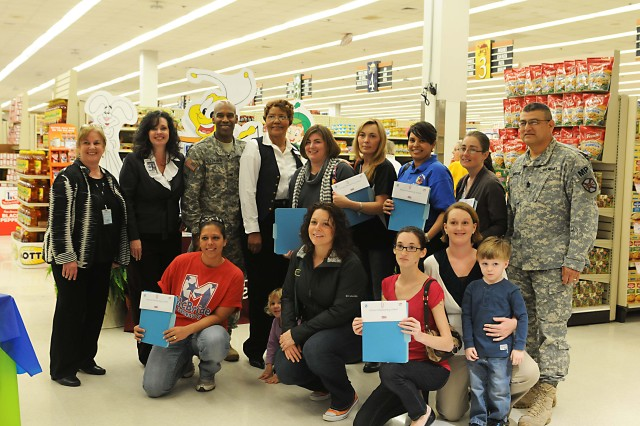 Parent-Teacher Organization members stand with Darlene Chaney of General Mills, left, Christy Cabezas, Georgia and Alabama school district superintendent, Col. Jeffrey Fletcher, post garrison commander, and Lillie Burns, grocery manager for the commissary. Also in attendance were several school principals.