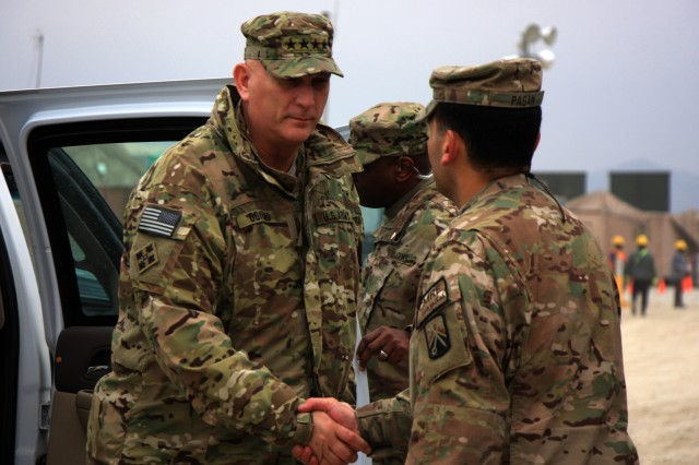 U.S. Army Chief of Staff Gen. Raymond T. Odierno, left, greets Maj. Rosendo Pagan, the 18th Combat Sustainment Support Battalion's executive officer, during a visit to the Bagram Retrosort Yard in Parwan province, Afghanistan, Feb. 21, 2013. The yard is a central part of the logistics chain for the redeployment of Army property in Afghanistan.