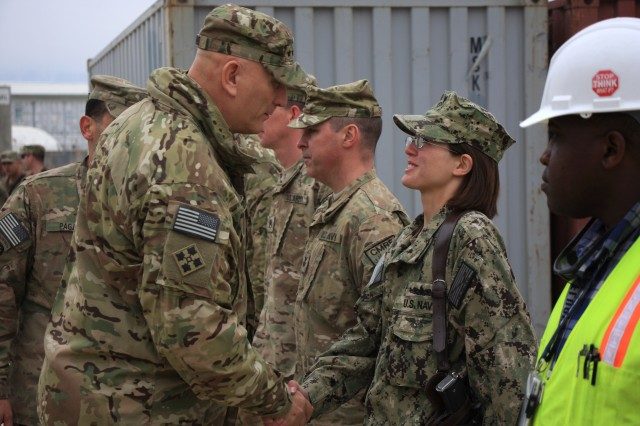 U.S. Army Chief of Staff Gen. Raymond T. Odierno, left, greets U.S. Navy Petty Officer 1st Class Janelle Switzer, a customs and border clearance agent, during a visit to the Bagram Retrosort Yard in Parwan province, Afghanistan, Feb. 21, 2013. The joint Army-Navy facility serves as a central part of the logistics chain for the redeployment of military property in Afghanistan.