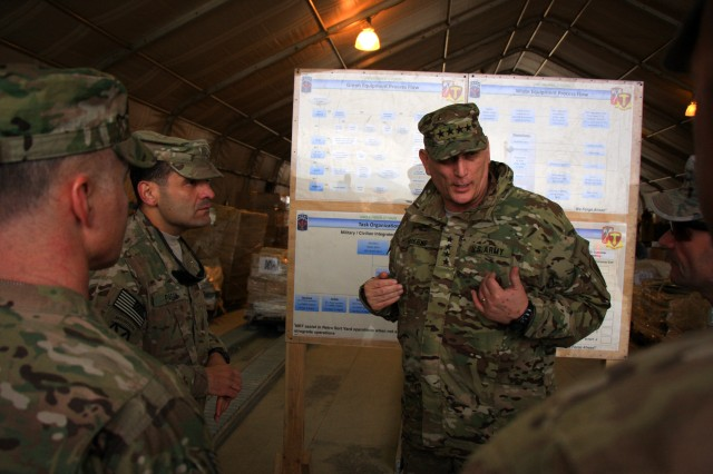 U.S. Army Chief of Staff Gen. Raymond T. Odierno, center, speaks with Soldiers assigned to the 18th Combat Sustainment Support Battalion during a visit to the Bagram Retrosort Yard in Parwan province, Afghanistan, Feb. 21, 2013. The yard is a central part of the logistics chain for the redeployment of Army property in Afghanistan.