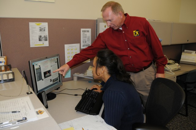 Bryan Tharpe, Army Career and Alumni Program transition service manager, and Troi Hayes, ACAP administrative specialist, review the program's website in their office at Bldg. 5700 Feb. 15. ACAP exists to help transitioning Soldiers be ready for their lives outside of the military.
