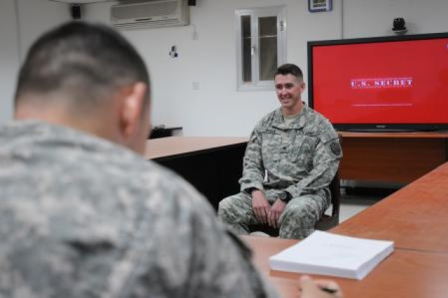 Sgt. Aaron Starr Byron answers questions during a structured local board at Camp Victory in Iraq May 25, 2011. This type of board makes recommendations to the Officer Candidate School selection board on whether applicants should be selected to go to OCS.
