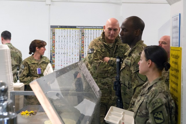U.S. Army Chief of Staff Gen. Raymond T. Odierno stand in line at the chow hall inside Combined Joint Task Force-1/Regional Command East headquarters in Bagram Airfield, Afghanistan, Feb. 21, 2013.