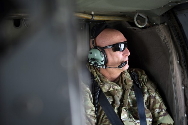 U.S. Army Chief of Staff Gen. Raymond T. Odierno looks out the window aboard a UH-60 Black Hawk helicopter on a flight to Bagram Airfield to Kabul, Afghanistan, Feb. 20, 2013.