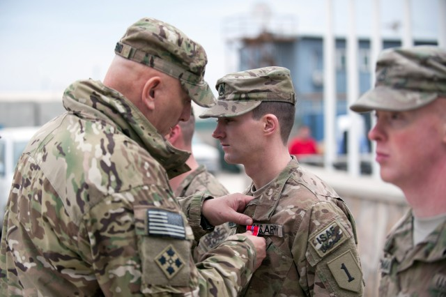 U.S. Army Chief of Staff Gen. Raymond T. Odierno presents Bronze Star Medals to Soldiers from Combined Joint Task Force-1/Regional Command East at Bagram Airfield, Afghanistan, Feb. 21, 2013.