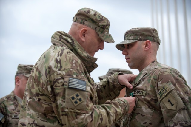 U.S. Army Chief of Staff Gen. Raymond T. Odierno presents Army Commendation Medals to Soldiers from Combined Joint Task Force-1/Regional Command East at Bagram Airfield, Afghanistan, Feb. 21, 2013.