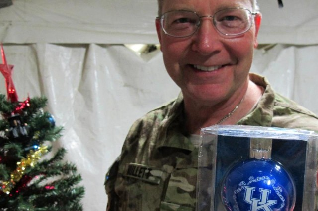 Army Col. Timothy Mullett receives a reminder of home while he was serving in Afghanistan. Mullett returned Dec. 31, 2012 after a 90-day deployment.