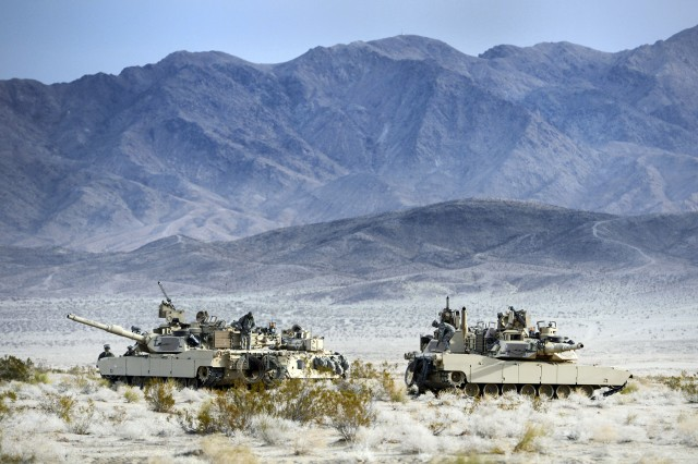 Soldiers in Abrams tanks from the 2nd Armored Brigade Combat Team, 1st Infantry Division, participate in a decisive action training exercise at the National Training Center, Fort Irwin, Calif., Feb. 21, 2013. The brigade will regionally align with U.S. Africa Command in early May 2013.