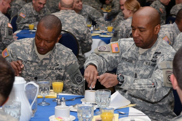 U.S. Soldiers prepare to eat during the national prayer breakfast at Fort Bragg, N.C., Feb. 20, 2013. The prayer breakfast was held in order to unite different religions and pray for the  deployed soldiers, wounded warriors, and military families. (U.S. Army photo by Sgt. Jared N. Gehmann/Released)