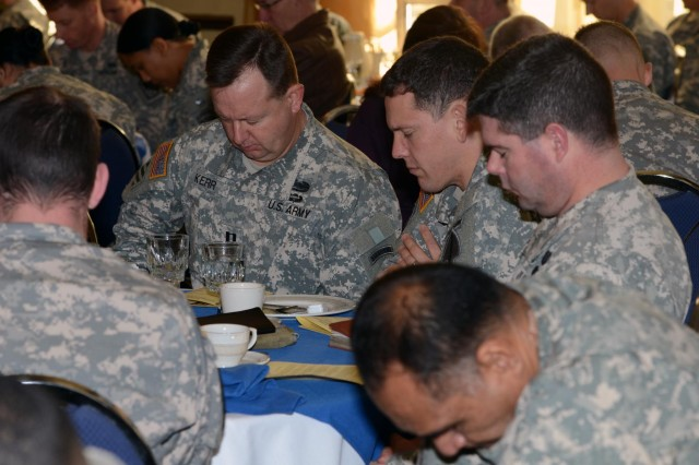 U.S. Soldiers pray for wounded warriors during the national prayer breakfast at Fort Bragg, N.C., Feb. 20,2013. (U.S. Army photo by Sgt. Jared N. Gehmann/Released)