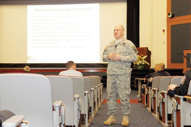 CAPE Director Col. Jeffery Peterson explains to Fort Belvoir garrison employees the U.S. Army's Center for the Army Profession and Ethic mission and objectives and how they relate to the garrison's ongoing daily activities, during a presentation in Thurman Hall at the Army Management Staff College, Feb. 14.