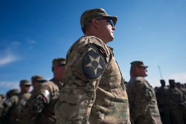 Soldiers from the 4th Stryker Brigade Combat Team, 2nd Infantry Division, stand in a horseshoe formation and listen to Army Chief of Staff Gen. Raymond T. Odierno during his visit to Forward Operation Base Masum Ghar, Afghanistan, Feb. 22, 2013.