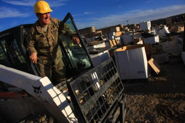 Sgt. Andrew Markley, Forward Operating Base Sharana Materiel Redistribution Yard noncommissioned officer-in-charge with the 289th Quartermaster Company, stationed out of Fort Hood, Texas, steps out of his forklift after a long day's work.