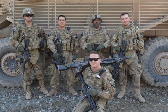 The Buffalo crew of Route Clearance Platoon 73, C Company, 4th Brigade Special Troops Battalion, 4th Brigade Combat Team, 1st Cavalry Division, from left to right- Spc. Ryan Hogan, Staff Sgt. Richard Lugo, Pfc. Quentin Clark, Spc. Kyle Gutfleisch, and front- Spc. Frank McNabb, after completing a RCP mission on Feb. 10, 2013. (Photo by U.S. Army 1st Lt. Rachel Fikes, B Co., 4th BSTB, 4th BCT, 1st Cav. Div.)