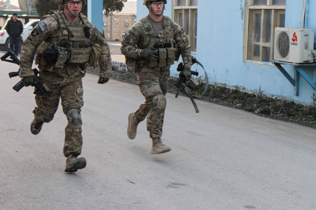 "KHOWST PROVINCE, Afghanistan "" Staff Sgt. Timothy Reinker, and infantry squad leader assigned to Company A, 1st Battalion, 187th Infantry Regiment, 3rd Brigade Combat Team ""Rakkasans,"" 101st Airborne Division (Air Assault), and Spc. Dustin Turner, and infantryman assigned to Troop C, 1st Squadron, 33rd Cavalry Regiment, get a running start at the beginning of the brigade non-commissioned officer and Soldier of the quarter competition on Forward Operating Base Salerno, Afghanistan,  Feb. 15, 2013. The competition included a five-mile march and five different combat related stations throughout the competition. (U.S. Army photo by Spc. Brian Smith-Dutton, Task Force 3/101 Public Affairs)"
