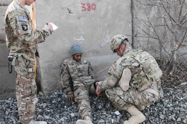 "KHOWST PROVINVE, Afghanistan "" Sgt. Jose Peneloza, a field artillery automated tactical data systems specialist assigned to 3rd Battalion, 320th Field Artillery Regiment, 3rd Brigade Combat Team ""Rakkasans,"" 101st Airborne Division (Air Assault), conducts first aid on a simulated casualty during the brigade non-commissioned officer and Soldier of the quarter competition on Forward Operating Base Salerno, Afghanistan, Feb. 15, 2013. Competitors were timed on performing a five mile road march as well as complete five stations throughout the competition. (U.S. Army photo by Spc. Brian Smith-Dutton, Task Force 3/101 Public Affairs)"