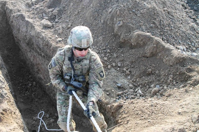 "KHOWST PROVINCE, Afghanistan "" Pfc. Benjamin Metzgar, a cavalry scout assigned to Troop B, 1st Squadron, 33rd Cavalry Regiment, 3rd Brigade Combat Team ""Rakkasans,"" 101st Airborne Division (Air Assault), uses a rope to climb out of a large hole during the obstacle course portion of the brigade non-commissioned officer and Soldier of the quarter competition on Forward Operating Base Salerno, Afghanistan,  Feb. 15, 2013. The competition included a five-mile march and five different combat related stations throughout the competition. (U.S. Army photo by Spc. Brian Smith-Dutton, Task Force 3/101 Public Affairs)"
