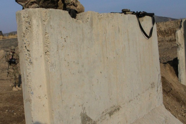 "KHOWST PROVINCE, Afghanistan "" Staff Sgt. Robert Dodge, a cavalry scout assigned to Troop B, 1st Squadron, 33rd Cavalry Regiment, 3rd Brigade Combat Team ""Rakkasans,"" 101st Airborne Division (Air Assault), climbs over a cement wall during the obstacle course portion of the brigade non-commissioned officer and Soldier of the quarter competition on Forward Operating Base Salerno, Afghanistan, Feb. 15, 2013. Competitors were timed on performing a five mile road march as well as complete five stations throughout the competition. (U.S. Army photo by Spc. Brian Smith-Dutton, Task Force 3/101 Public Affairs)"