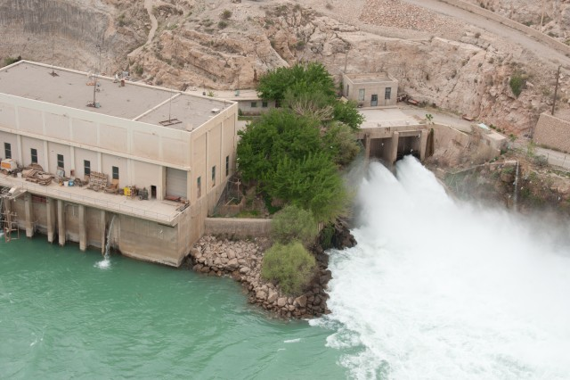 Water exits through the outlet end of Kajaki Dam's irrigation tunnel into the Helmand River. The U.S. Army Corps of Engineers awarded three projects in late January 2013 that will improve water control at the dam.