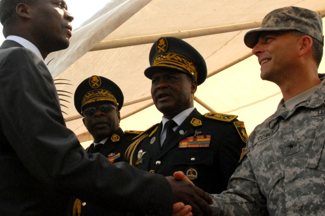 Brig. Gen. Peter Corey, the deputy commander of U.S. Army Africa and senior U.S. Army official for exercise Central Accord 2013, shakes hands with Joseph Beti Assomo, the Governor of Littoral Region, where Central Accord will be held during the opening ceremony of exercise at the 102 Air Force Base airfield in Douala, Cameroon, Feb. 20, 2013. Cameroon and the U.S. will partner throughout the 10-day exercise to hone their joint aerial resupply and medical evacuation skills.
