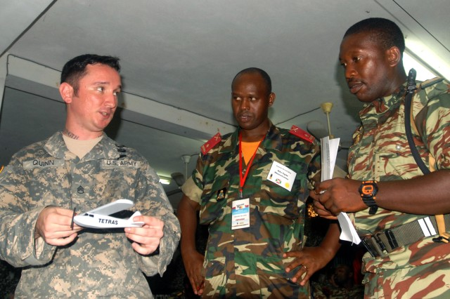 A Cameroon soldier and Gabonese Republic soldier ask U.S. Army Staff Sgt. Michael Quinn, a pathfinder instructor, with the 356th Battlefield Surveillance Brigade, of the Georgia Army National Guard, a question during a break in pathfinder basic instruction. The soldiers were participating in Central Accord 2013, a joint exercise in which U.S., Cameroon and neighboring Central African militaries partner to promote regional cooperation while and increasing aerial resupply and medical readiness capacity.