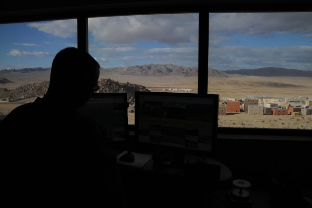 "Soldiers in range control towers like this, overlooking mock towns, are able to adjust the intensity for visiting ""Dagger"" Brigade Soldiers, at Fort Irwin, Calif. The intensity includes such things as smoke, various sounds one might hear in a village including an attack, and a variety of smells including vomit and burning flesh. It is designed to stress the Soldiers in training rather than have it happen in combat."