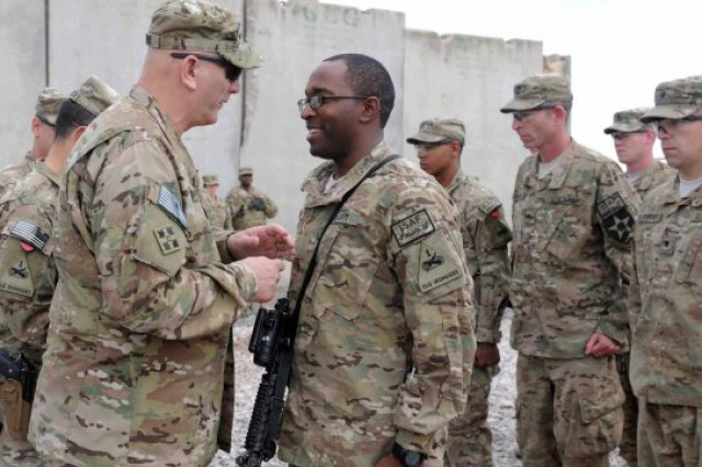 U.S. Army Chief of Staff Gen. Raymond T. Odierno (left) promotes Warrant Officer Shaun Mance to the rank of Chief Warrant Officer 2 at Forward Operating Base Frontenac in Kandahar province, Afghanistan, Feb. 22, 2013.