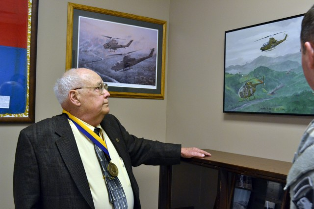 "FORT CAMPBELL, Ky. (Feb. 25, 2013) - Retired platoon sergeant, Sgt. 1st Class Cecil Wiggins reminisces as he tours the 2nd Squadron, 17th Cavalry Regiment, memorabilia collection after receiving the Order of St. Michael Bronze Award during a ceremony here Feb. 22. Wiggins, a member of the 507th Transportation Company Detachment, attached to the ""Condors,"" Company C, 2nd Sqdn., 17th Cav. Regt., during the Vietnam War, used his skills as a leader to boost both morale and production of the unit. (U.S. Army photo by Spc. Jennifer Andersson, 159th Combat Aviation Brigade Public Affairs/RELEASED)"