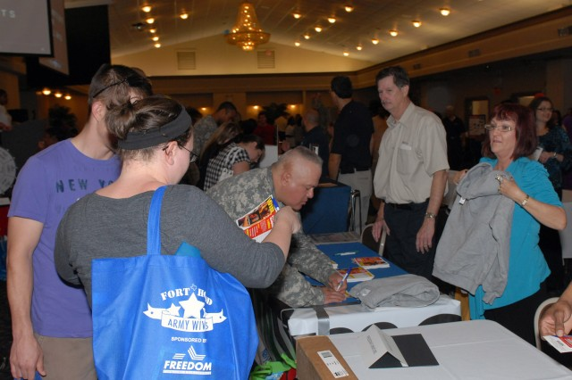 Soldiers and Family members take advantage of the services offered at the Hood Howdy event held at Club Hood Feb. 7. The event is sponsored by Army Community Services and Morale, Welfare, and Recreation and helps newer Soldiers and their Families become aware of the services available to them at the Great Place. (Photo by Sgt. William Begley, 11th PAD)