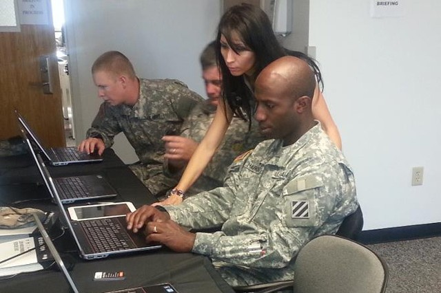 During a visit to Fort Stewart, Ga., H2H Employment Transition Coordinators assist service members with building their profile.