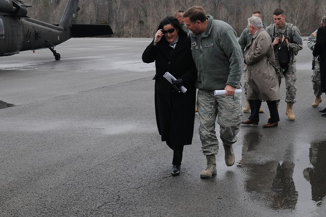 Kentucky's adjutant general, Maj. Gen. Edward W. Tonini walks with Assistant Secretary of the Army Katherine Hammack following an aerial tour of the Wendell H. Ford Regional Training Center