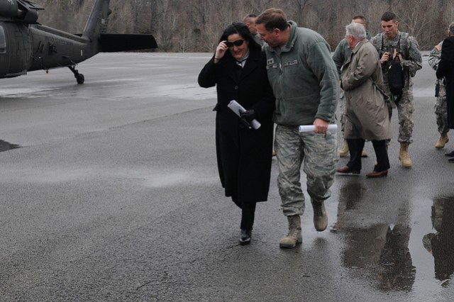 Kentucky's adjutant general, Maj. Gen. Edward W. Tonini walks with Assistant Secretary of the Army Katherine Hammack following an aerial tour of the Wendell H. Ford Regional Training Center in Greenville, Ky., Feb. 22, 2013. Hammack paid the visit to present the facility the 2012 Natural Resources Conservation Award for large Army installations. (Kentucky National Guard photo by Pfc. Sarah Anderson)