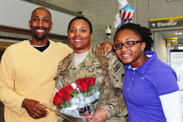 Master Sgt. Daphney Cole-Smith, a native of Laurel, Miss., is greeted by her husband, Joseph, and daughter, Jelisa, at the Jackson-Evers International Airport when she returned home from Afghanistan Feb. 15, 2013.  Cole-Smith, a member of the 412th Theater Engineer Command based in Vicksburg, deployed for nine months with the 411th Engineer Brigade out of New Windsor, N.Y., in support of Operation Enduring Freedom.