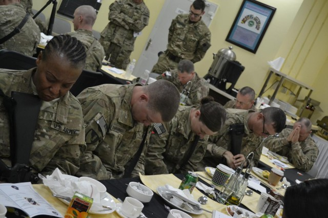 Soldiers with the 3rd Sustainment Brigade-Task Force Provider, take time out for spiritual fitness at Kandahar Airfield, Afghanistan, Feb. 20. The 'Providers' hosted their first prayer breakfast of the deployment in an effort to keep soldiers spiritually fit and to strengthen their character and values. (U.S. Army photo by Spc. Rochelle Krueger, 3rd Sustainment Brigade Public Affairs)