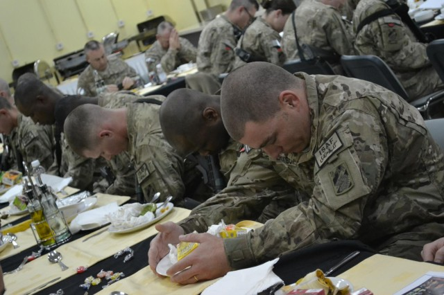 U.S. Soldiers with the 3rd Sustainment Brigade,Task Force Provider, bow their heads in prayer at a prayer breakfast held at Kandahar Airfield, Kandahar province, Afghanistan, Feb. 20, 2013. The unit hosted their first prayer breakfast of the deployment in an effort to keep Soldiers spiritually fit and to strengthen their character and values. (U.S. Army photo by Spc. Rochelle Krueger/Released)