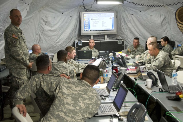 Lt. Col. Vincent Yznaga U.S. Army South Contingency Command Post Deputy Chief of Operations, talks with members of the Rapid Response Deployable Detachment during Integrated Advance 2013.