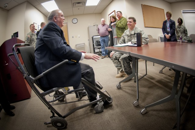 Under Secretary of the Army Joseph W. Westphal chats with Spc. Joshua O'Neil, 23, at Walter Reed National Military Medical Center, in Bethesda, Md., on Feb. 26, 2013 after he presented the Soldier with the Purple Heart, one of the nation's most respected military medals.  The gunner sustained injuries while on mounted patrol in Kandahar, Afghanistan on Feb. 11.  (U.S. Army photo by Staff Sgt. Bernardo Fuller)