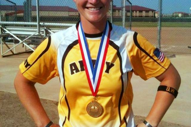 2012 Army Female Athlete of the Year, Sgt. Ashley Walker with the 425th Brigade Special Troops Battalion, 4th Brigade Combat Team (Airborne), 25th Infantry Division, poses for a picture with her gold medal just after winning the 2012 Armed Forces Championship in September 2012, at Fort Sill, Okla.