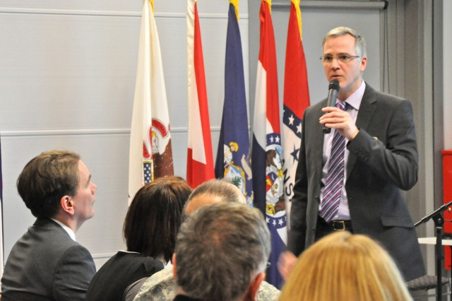 U.S. Army Garrison Wiesbaden Housing Manager Donald Meyer describes how the Housing Office operates during the host nation housing outreach Feb. 20.