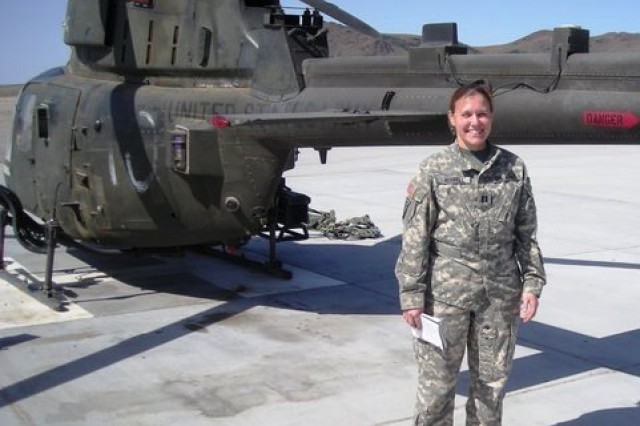 Capt. Amy Ferrell, operations officer at 1st Battalion, 337th Aviation Regiment, 166th Aviation Brigade, First Army Division West, during pre-flight inspections as she prepares for an evening mission during April 2010, at the National Training Center, Fort Irwin, Calif.
