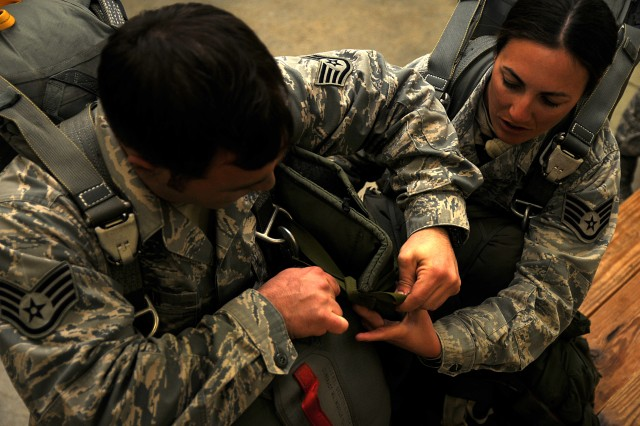 Air Force Paratroopers help each other don their equipment prior to an airborne operation, Feb. 23. Airmen assigned to 820th RED HORSE Squadron from Nellis Air Force Base, Nev., traveled to Fort Bragg, N.C., to conduct the airborne operation and airfield maintenance training with 161st Engineer Company, 27th Eng. Battalion, 20th Eng. Brigade. Both units will be augmenting 2nd Brigade Combat Team, 82nd Airborne Division for the Joint Operational Access Exercise, Feb. 27-March 9, as well as supporting 2BCT's Global Response Force mission.