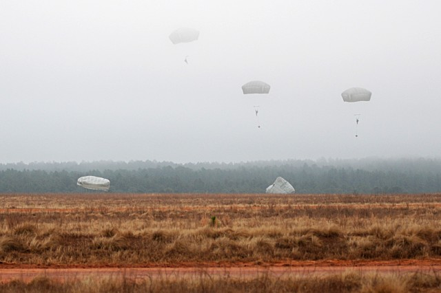 The silhouettes of Paratroopers break through the cloud ceiling during an airborne operation, Feb. 23. Airmen assigned to 820th RED HORSE Squadron from Nellis Air Force Base, Nev., traveled to Fort Bragg, N.C., to conduct the airborne operation and airfield maintenance training with 161st Engineer Company, 27th Eng. Battalion, 20th Eng. Brigade. Both units will be augmenting 2nd Brigade Combat Team, 82nd Airborne Division for the Joint Operational Access Exercise, Feb. 27-March 9, as well as supporting 2BCT's Global Response Force mission.