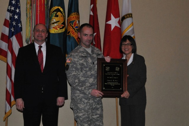 Lt. Col. Jeffery Phillips, MICC-Fort Knox director, accepts the AbilityOne Award on behalf of Deborah Ault.