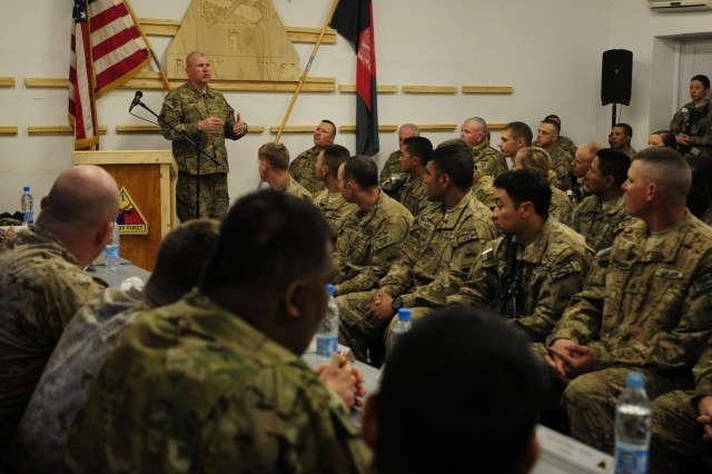 Col. Kenneth P. Adgie, 1st Brigade, 1st Armored Division commander, speaks to Combined Task Force Ready First Soldiers, Feb. 27, 2013, before introducing the wounded warriors visiting with Operation Proper Exit II, at Camp Nathan Smith, Afghanistan. The nine wounded warriors returned to Afghanistan to speak with service members and leave the country on their own terms.