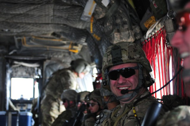 Medal of Honor recipient Sgt. 1st Class Leroy Petry flashes a smile, Feb. 27, 2013, during a CH-47 Chinook flight to Camp Nathan Smith, Afghanistan. Petry returned to Afghanistan with eight other wounded warriors in order to leave the country on his own terms under Operation Proper Exit II.