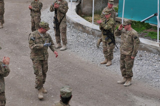 Medal of Honor recipient Sgt. 1st Class Leroy Petry returns the salute of a Ready First Soldier, Feb. 27, 2013, at Camp Nathan Smith, Afghanistan. Petry returned to Afghanistan with eight other wounded warriors to speak with service members and leave the country on his own terms under Operation Proper Exit II.